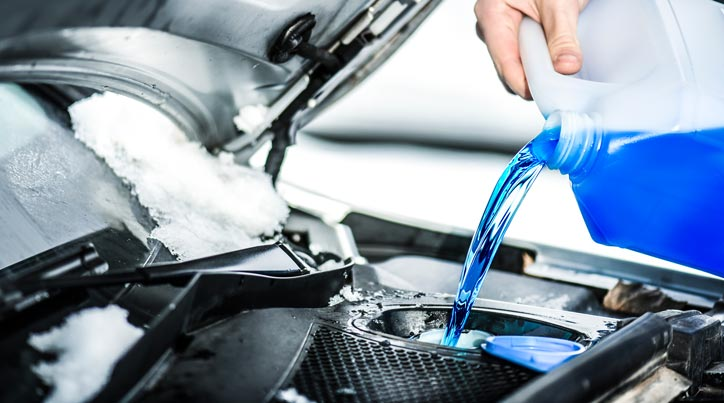 Antifreeze Being Poured Into The Car