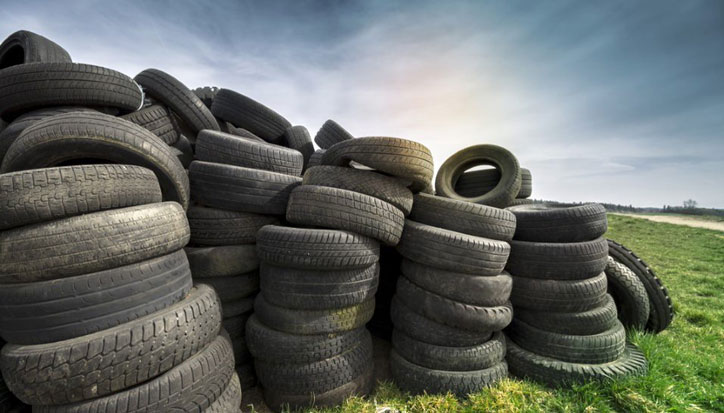 Used tyres in a field