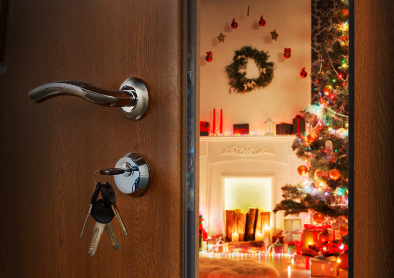 open door leading to a room decorated with Christmas decorations.